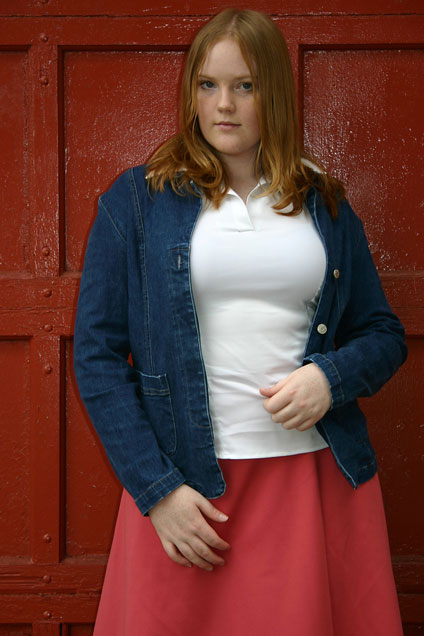 female model, wearing plus-sized garments