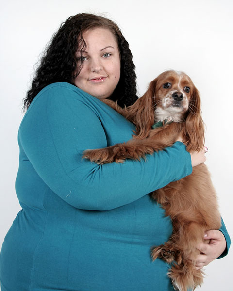 plus-sized woman posing with her pet dog